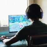 teenager-playing-fortnite-video-game-on-pc
